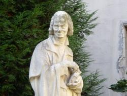 Voltaire. Buste de la statue dans le square derrière l'Institut de France