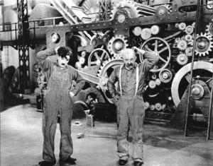 Les Temps modernes (Modern Times) de Charlie Chaplin questionnait déjà en 1936 sur la compatibilité entre progrès et épanouissement de l'homme