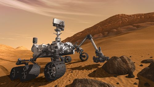 Le robot Curiosity sillonnera la terre martienne à la recherche de traces de vies fossiles. Vue d'artiste